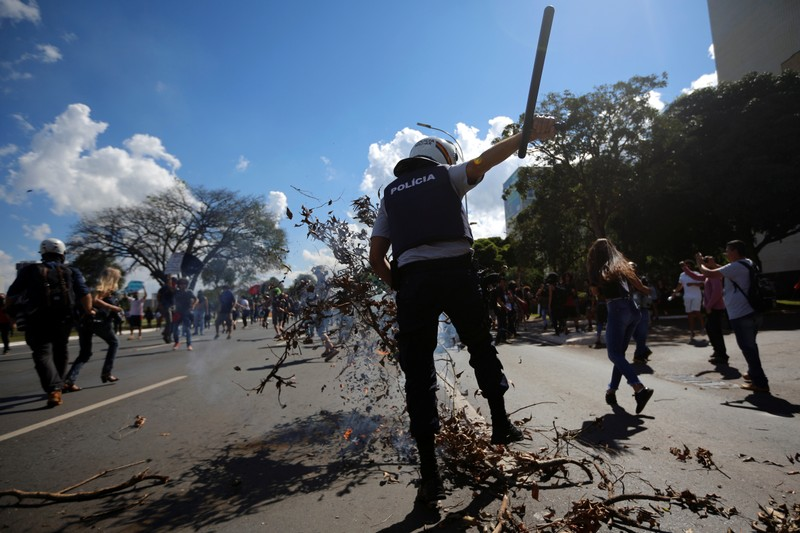A riot-police clashes university students during a protest against cuts to federal spending on higher education planned by Brazil's President Jair Bolsonaro's right-wing government in Brasilia