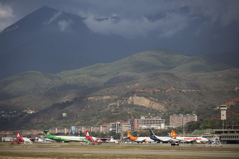 FILE PHOTO: Aircraft are seen at a runway on the Simon Bolivar airport in Caracas