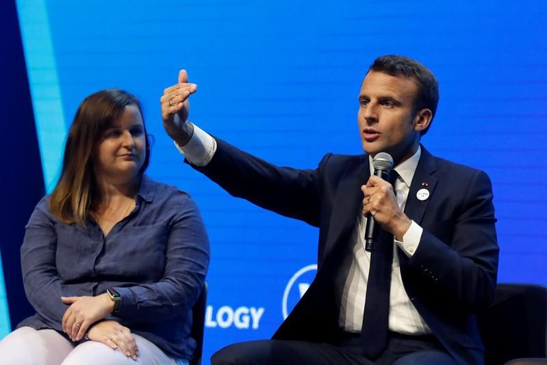 French President Emmanuel Macron talks to start-ups at VivaTech fair in Paris