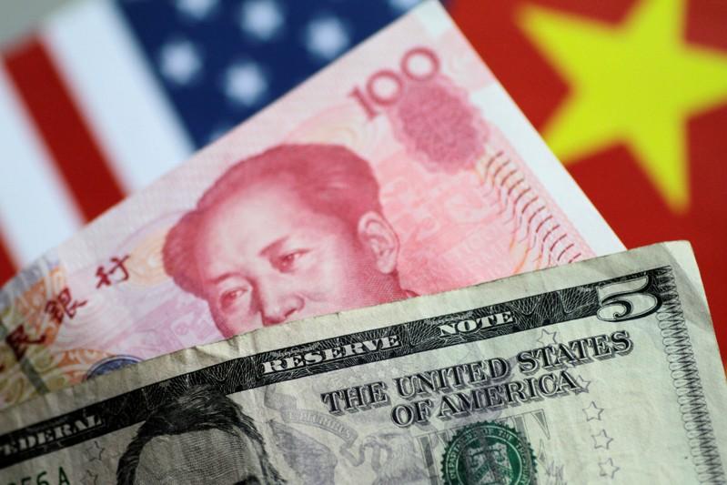 FILE PHOTO: Illustration photo of U.S. Dollar and China Yuan notes
