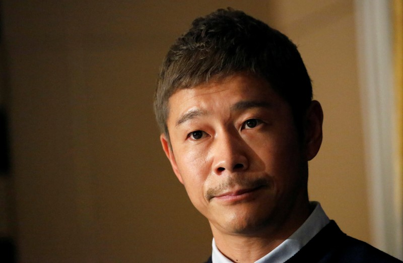 Japanese billionaire Yusaku Maezawa, founder and chief executive of online fashion retailer Zozo, who has been chosen as the first private passenger by SpaceX, attends a news conference at the Foreign Correspondents' Club of Japan in Tokyo