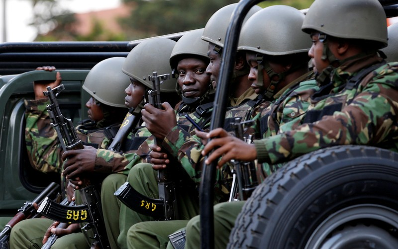 FILE PHOTO: Kenyan police officers drive in their truck as they arrive at the scene where explosions and gunshots were heard at the Dusit hotel compound, in Nairobi