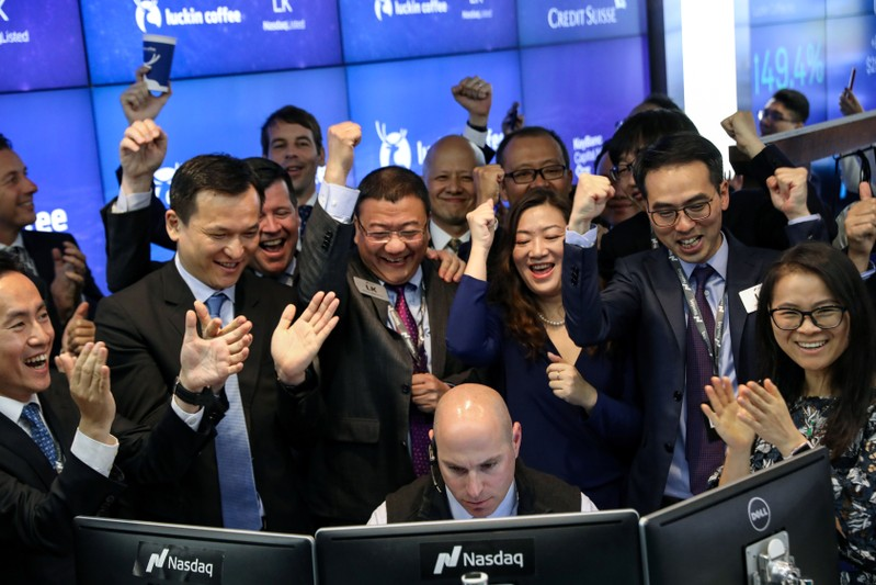 Jenny Qian Zhiya CEO of Luckin Coffee celebrates the company's stock trading during the IPO at the Nasdaq Market site in New York