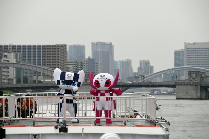 Tokyo 2020 Olympics Games mascots, Miraitowa and Someity ride on a boat during their debut event of water parade in Tokyo