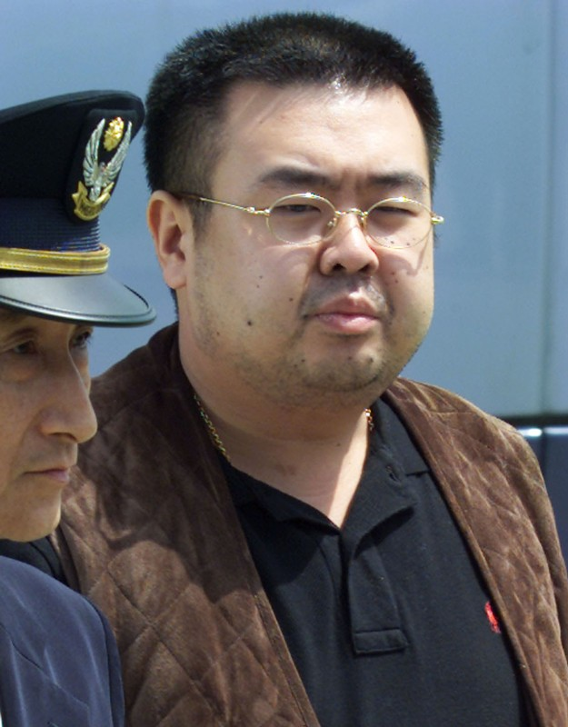 FILE PHOTO - KIM JONG NAM IS ESCORTED TO AN AIRPLANE