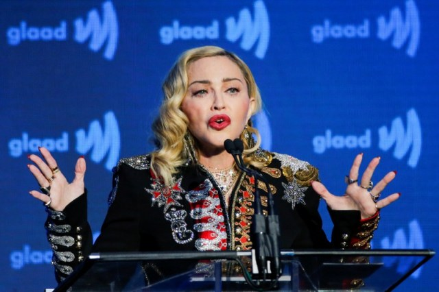 FILE PHOTO: Singer Madonna speaks to guests after receiving the Advocate for Change award during the 30th annual GLAAD awards ceremony in New York City, New York
