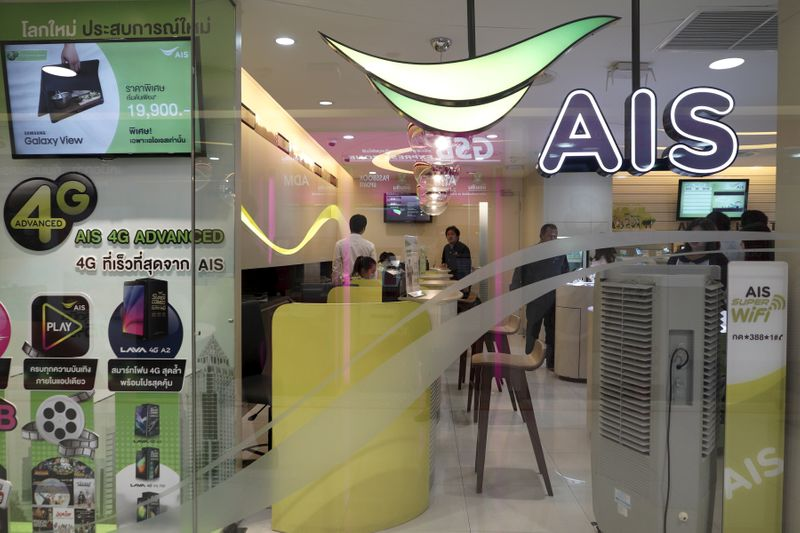 Customers wait for service at the AIS shop in  Bangkok