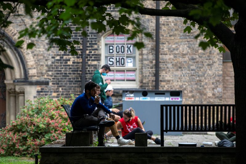 Students walk on the grounds of the University of Toronto in Toronto