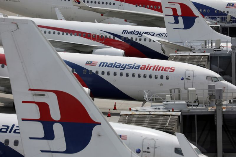 FILE PHOTO: Malaysia Airlines planes are seen parked at Kuala Lumpur International Airport, amid the coronavirus disease (COVID-19) outbreak in Sepang