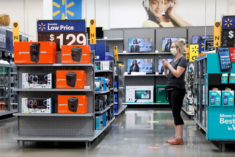 FILE PHOTO: A shopper is seen wearing a mask while shopping at a Walmart store in Bradford, Pennsylvania