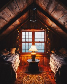 Vintage attic bedroom with wall of skylights23