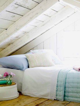 Vintage attic bedroom with wall of skylights46