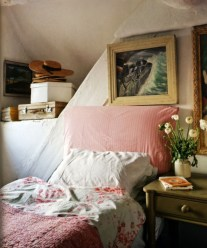Vintage attic bedroom with wall of skylights50