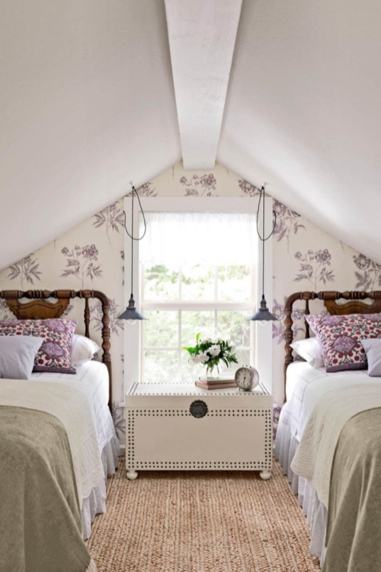 Vintage attic bedroom with wall of skylights55