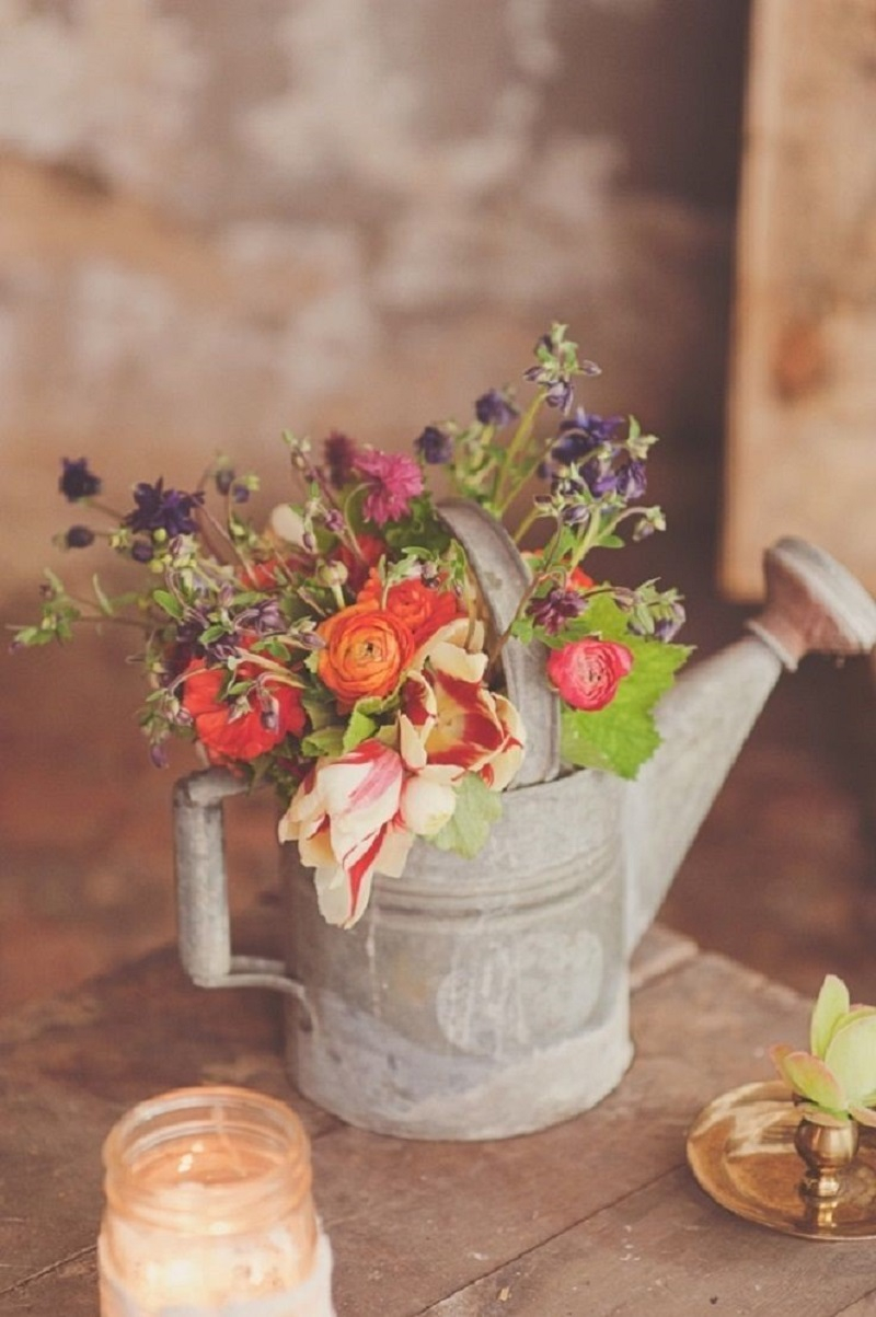 Old watering can planter