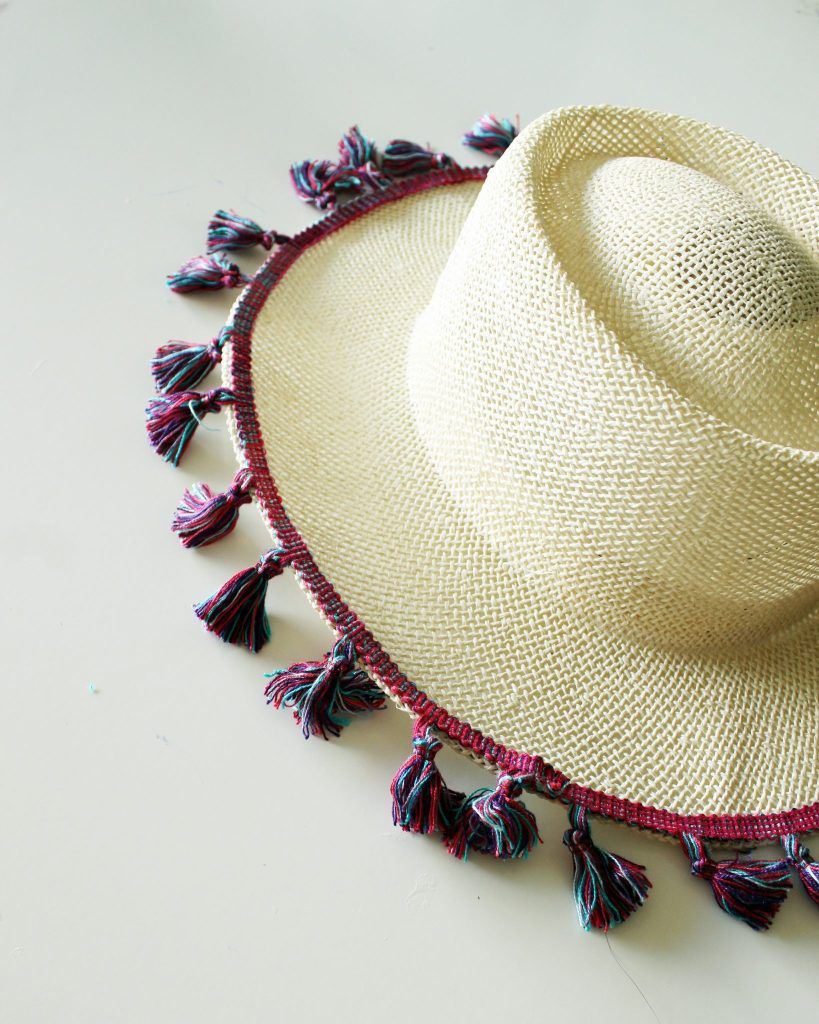 A beach hat with tassels DIY Hat Ideas That Requires Almost No Sewing And Precise Cuts Skill