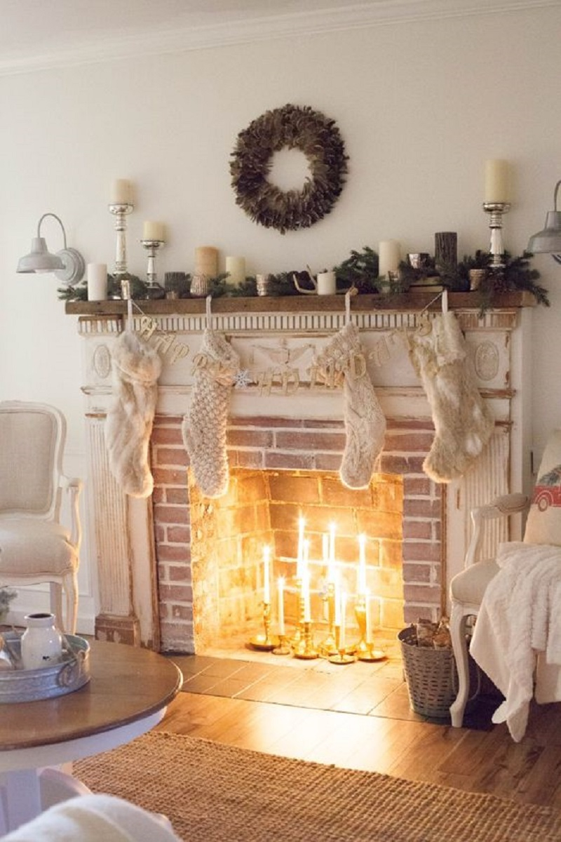 Brick fireplace with a white shabby chic mantel