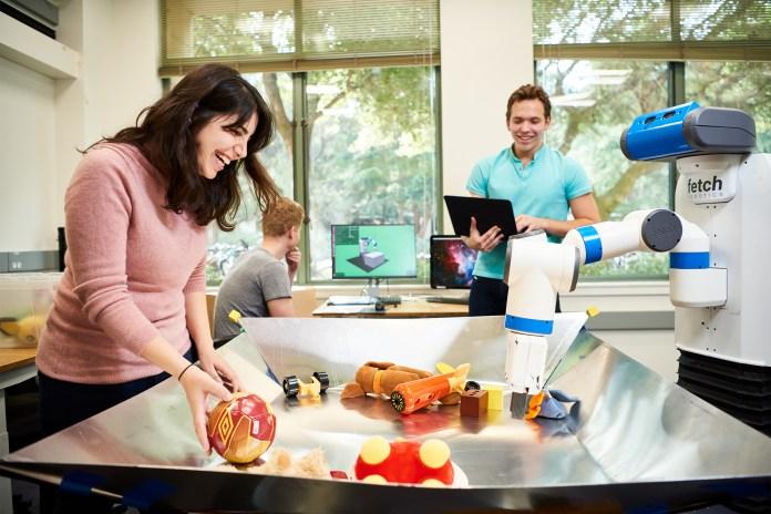 Dorsa Sadigh and a robot.