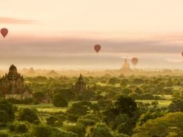 Hot air balloons dot the morning sky in Bagan, Myanmar, things to see in Myanmar