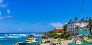Boats by the water at Tent Bay, Barbados tourism taxes