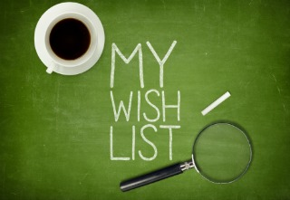 My wish list concept on green blackboard with coffee cup and paper plane