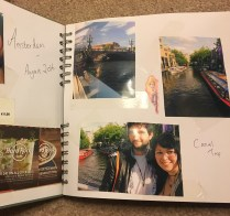 Image of a scrapbook. Photos from amsterdam with ticket stubs and titles are there.