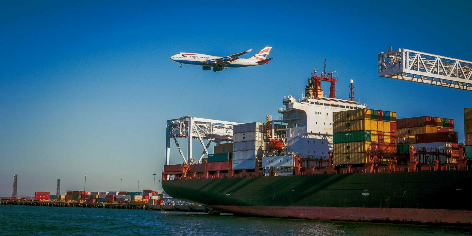 Picture of plane and shipping yard for Real Estate News for Investors Podcast Episode #776