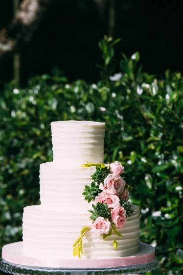The wedding cake featured succulents and roses