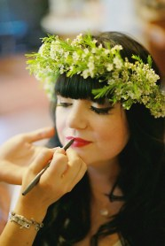 The bride wore winged liner, bold red lipstick and a flower crown