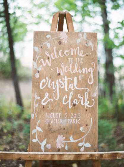 Greet guests with a handmade sign placed at the front of reception. Photo: Orange Photographie