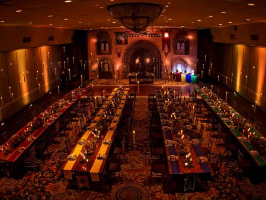 If you've got the budget, book a grand hall and separate your guests according to the four houses. Make sure to add enchanting lighting for that magical touch. Photo: So Photography