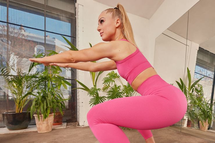 squat with hands in front of body