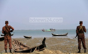 BGB personnel stand guard to stop boats carrying Rohingyas from Myanmar.