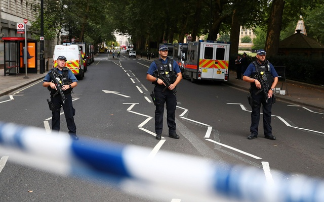Armed police officers stand at a cordon after a car crashed outside the Houses of Parliament in Westminster, London, Britain, Aug 14, 2018. REUTERS