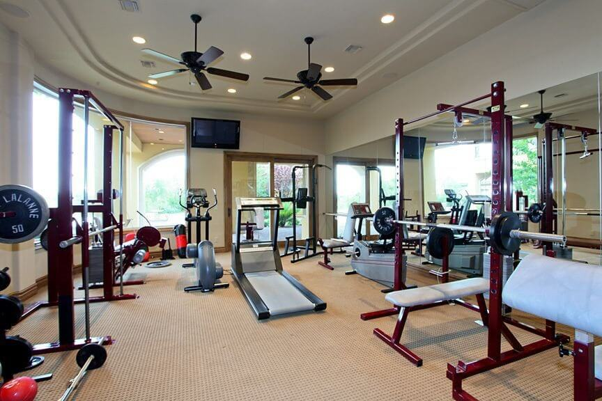 Home gym with plenty of free weight equipment.