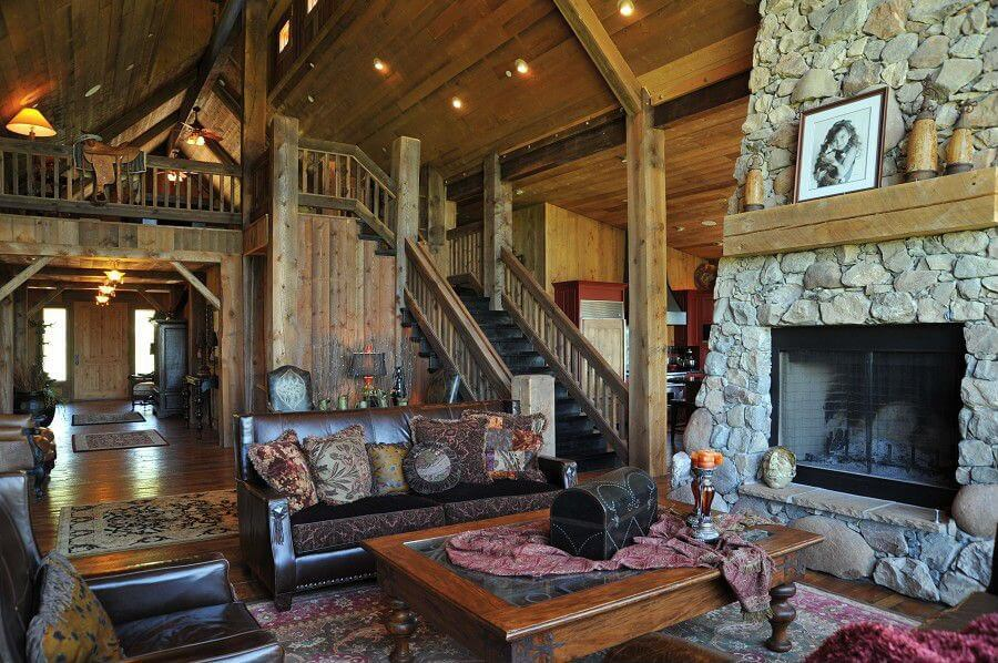 This large log home has several rooms in the loft space