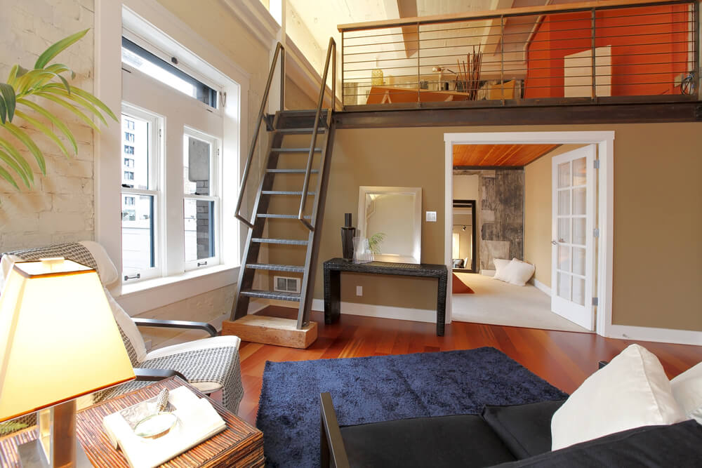 This home uses a loft to create two bedrooms.  It's possible because of the cathedral ceiling