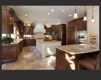 Richly detailed U-shaped kitchen centers dark wood ...
