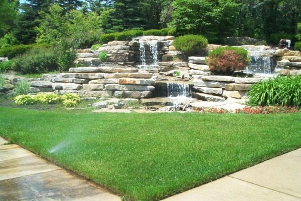 layered stone waterfall in corner