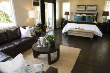 dark furniture sitting bedroom master area room living bedrooms flooring walls light brown modern sofa cream sectional floors floor hardwood