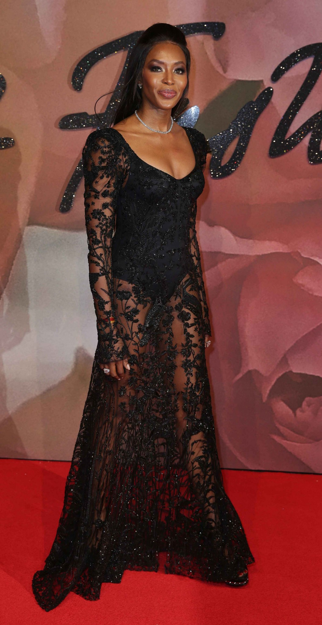 Fashion model Naomi Campbell in a lace gown