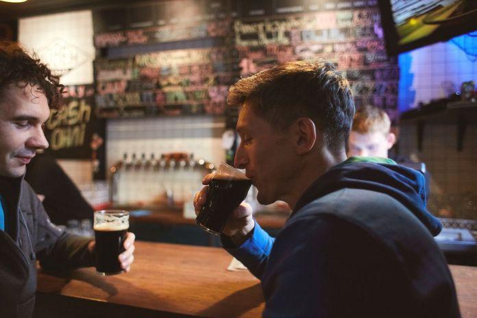 Friends drinking Guinness