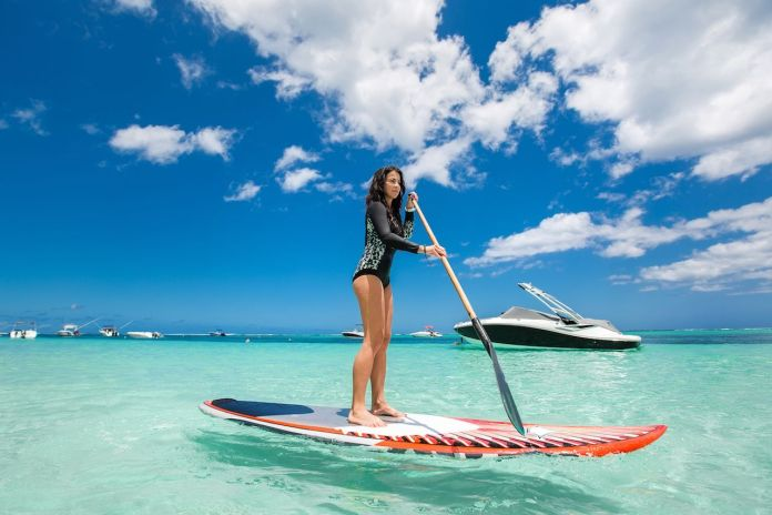 Woman SUPing in the tropics