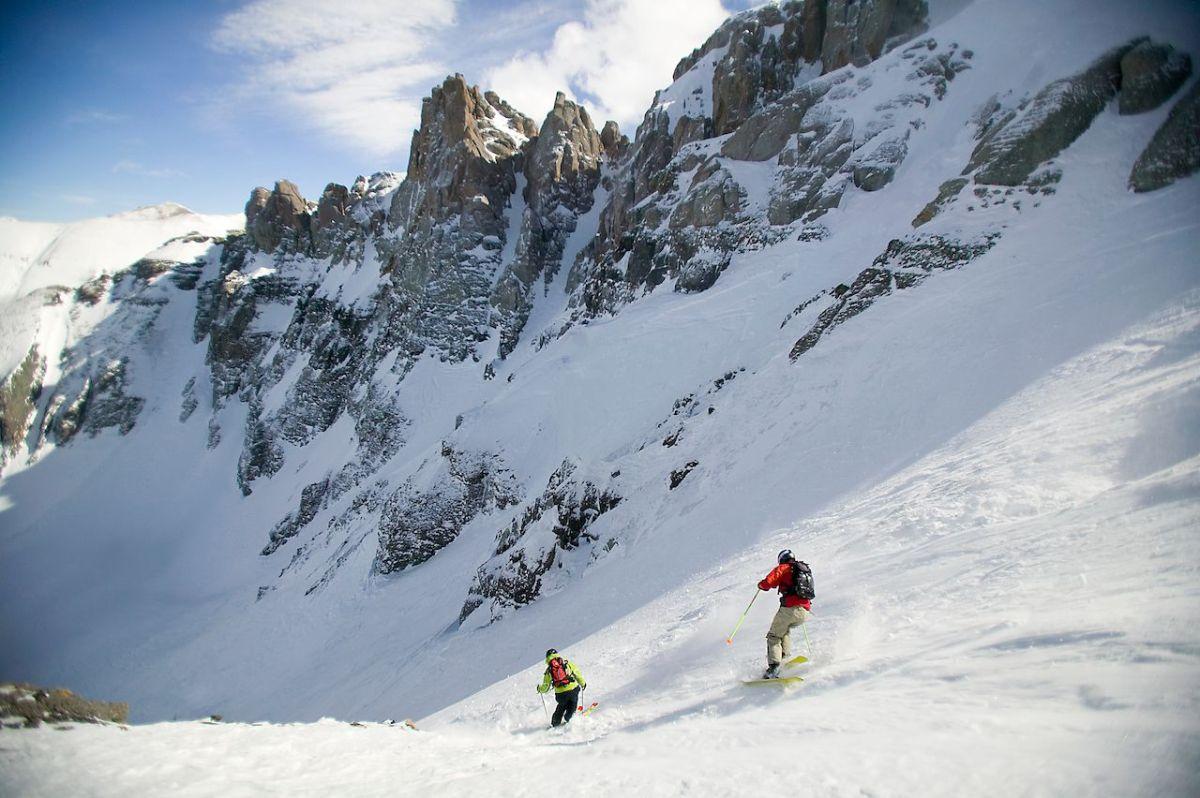 Two skiers descend Mountain Quail ski run at the Telluride Ski resort Telluride Colorado