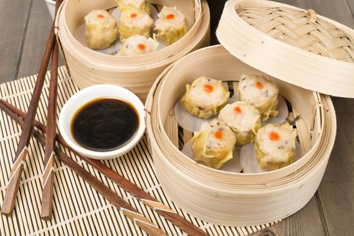 Chinese steamed pork dumplings in bamboo steamers