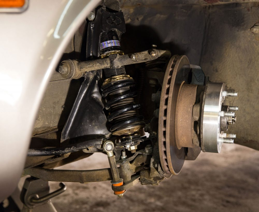 hight resolution of the factory suspension up front was a separate spring and shock with a double a arm suspension we deigned a system to fit inverted coils between the arms