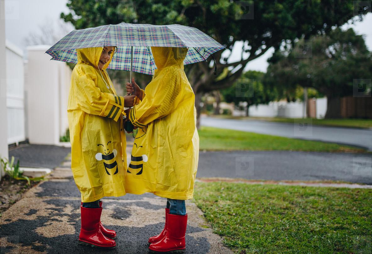 little girls with raincoats