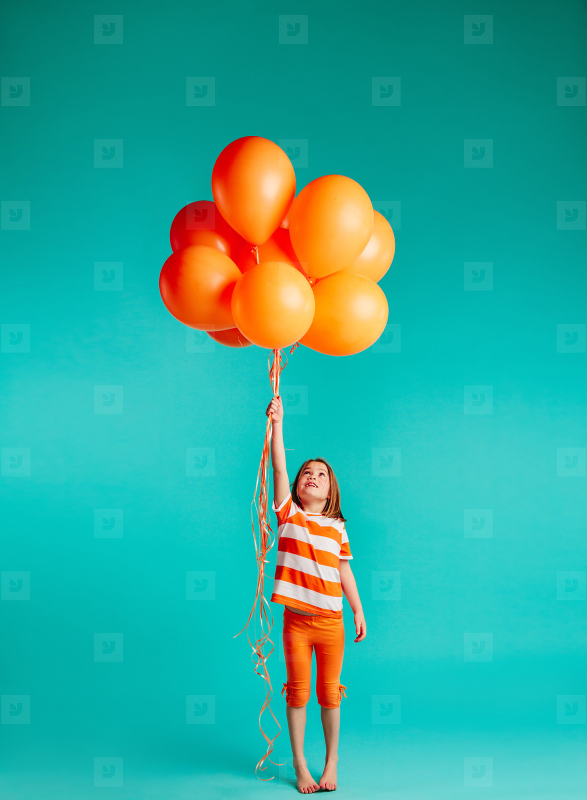 cute girl holding orange