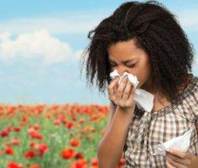 Woman Flowers Sneezing Allergies In Seattle Wa