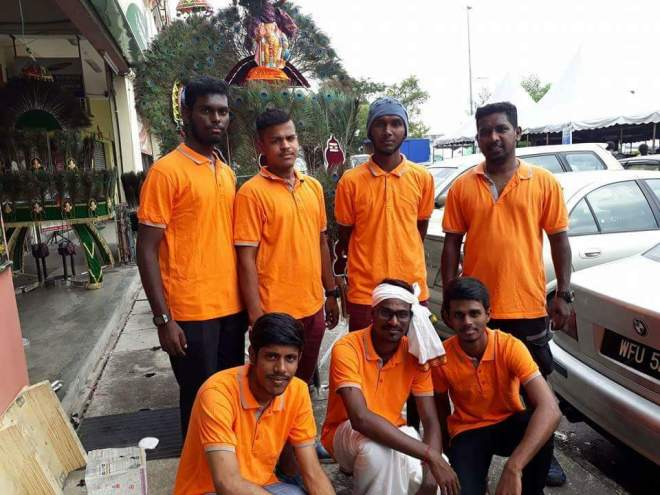 Saravanan (standing, far right) and his team.